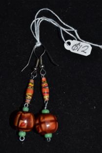 paper, seed and wooden beads on wire