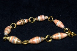Paper beads on wire with interlaced jump rings