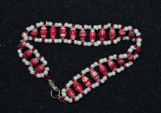 Red paper beads with white pearl and red seed beads on nylon thread - Ladder stitch