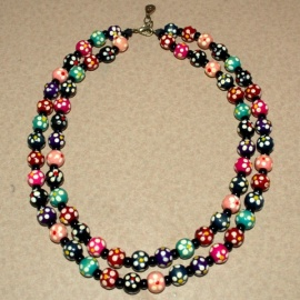 Painted wood and pearl beads on leather string